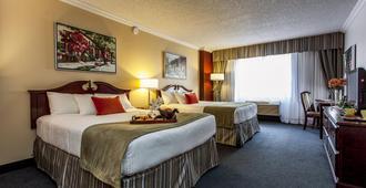 新休闲Spa酒店 - 蒙特利尔 - 睡房