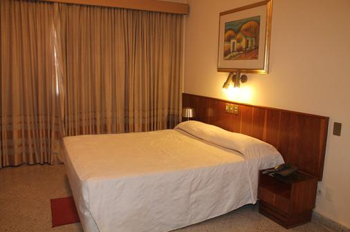 巴拉那格兰酒店 - 亚松森 - 睡房