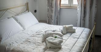 吉昂卡拉家庭旅馆 - 马拉泰亚 - 睡房