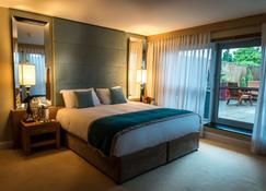 麗笙藍光Spa飯店 - 科克小島 - 科克 - 睡房