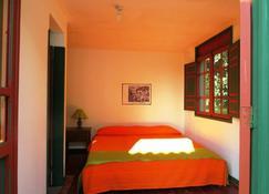 欧屯昆姆巴亚野生动物和植物保护区酒店 - 佩雷拉 - 睡房
