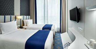 新加坡加东智选假日酒店 - 新加坡 - 睡房