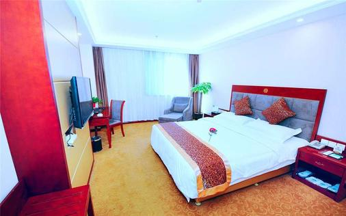 西安中心戴斯酒店 - 西安 - 睡房