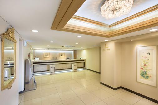 海云台里维埃拉酒店 - 釜山 - 柜台