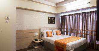 星球公寓酒店 - 孟买 - 睡房