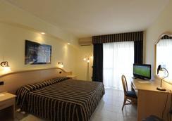 普格诺奇乌索法洛度假村酒店 - 维耶斯泰 - 睡房