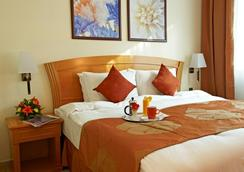 金色郁金香酒店式公寓 - 沙迦 - 睡房
