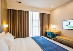 长沙国际会展中心宜必思尚品酒店 - 长沙 - 睡房