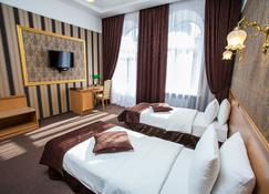 利泰拉酒店 - 第聂伯罗彼得罗斯夫斯克 - 睡房