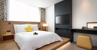 明洞L7乐天酒店 - 首尔 - 睡房