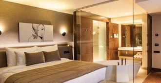 可龙威尔布拉索夫酒店 - 布拉索夫 - 睡房