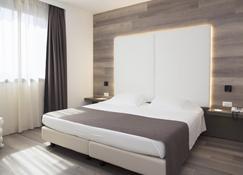 佛利诺城套房酒店 - 福利尼奥 - 睡房