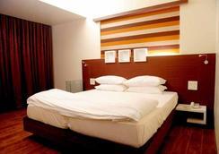 孟买皇家公园酒店 - 孟买 - 睡房