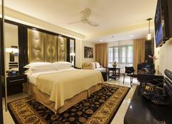 特拉诺娃全套房酒店 - 金斯敦 - 睡房