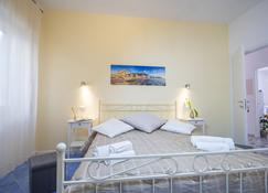 波西多尼亚 家庭旅馆 - 卡斯特拉巴特 - 睡房