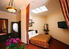 埃德姆酒店 - 利沃夫 - 睡房