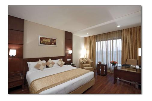 印多尔丽怡酒店 - 印多尔 - 睡房