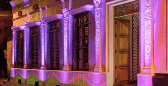 卡萨代勒达卡利酒店 - 圣玛尔塔 - 睡房
