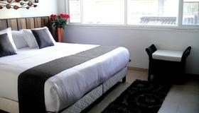 艾姆巴亚打菲利亚精品酒店 - 波哥大 - 睡房