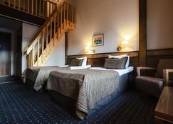 拉普兰罗斯托图恩图瑞酒店及紫水晶Spa - 南屈莱 - 睡房