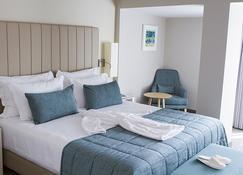 蒙特贝约吉拉索尔马布托酒店 - 马普托 - 睡房