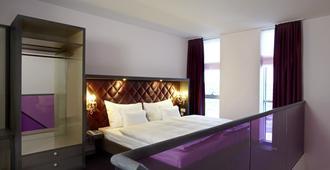 阿比托套房酒店 - 莱比锡 - 睡房