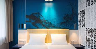 哈勒姆市宜必思风格酒店 - 哈莱姆 - 睡房