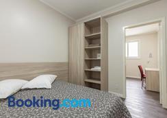 贡萨尔维斯酒店 - 阿雷格里港 - 睡房