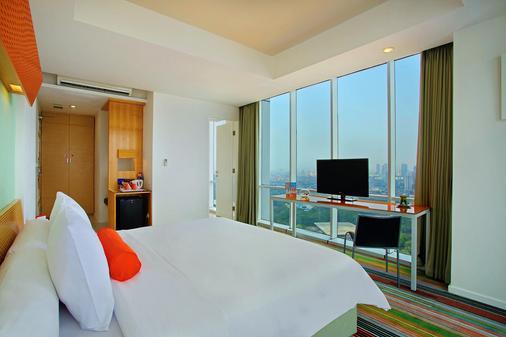 Fx苏迪曼哈里斯套房酒店 - 雅加达 - 睡房