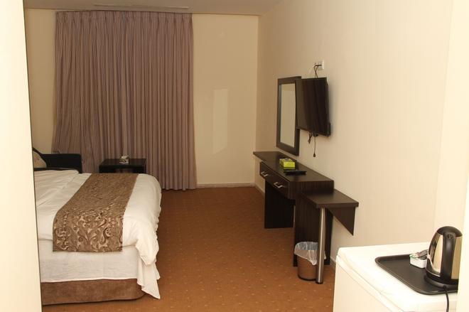 吉达宫殿酒店 - 安曼 - 睡房