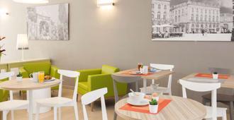 南锡中心阿德吉奥阿克瑟斯公寓式酒店 - 南锡 - 餐馆