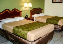 德克萨肯纳伊克诺酒店 - 特克萨卡纳 - 睡房
