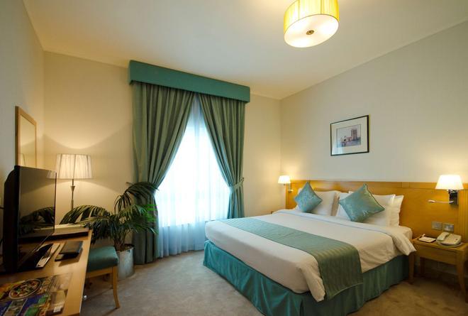 迪拜艾巴斯坦中心公寓 - 迪拜 - 睡房