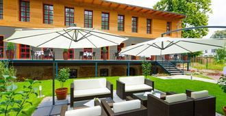 密查里斯酒店及餐厅 - 莱比锡 - 露台