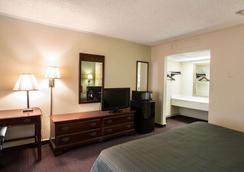 哈比森区品质酒店 - 哥伦比亚 - 睡房