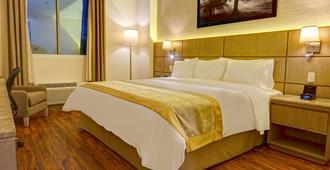 瓜亚基尔丽笙酒店 - 瓜亚基尔 - 睡房