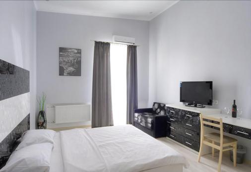 最佳季节公寓酒店 - 基辅 - 睡房