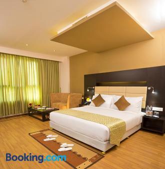 马杜赖坡匹斯酒店 - 马杜赖 - 睡房
