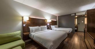 诺曼丁套房酒店 - 魁北克市 - 睡房
