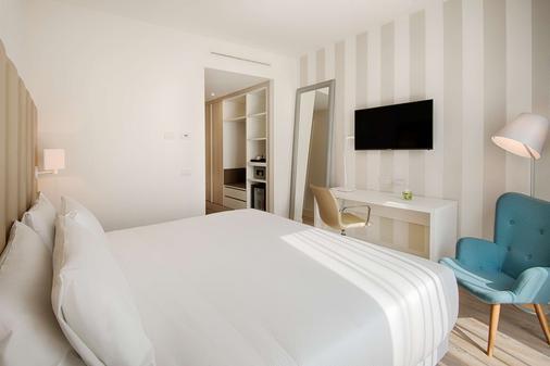 Nh特伦托酒店 - 特伦托 - 睡房