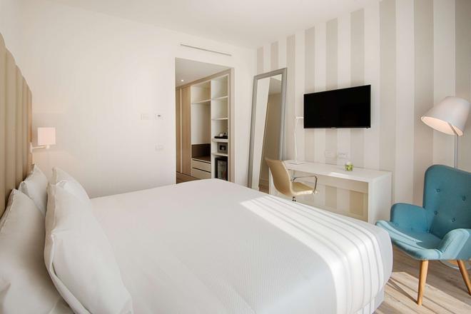 特伦托nh酒店 - 特伦托 - 睡房
