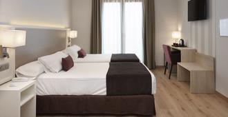麦斯特朗泽酒店 - 隆达 - 睡房