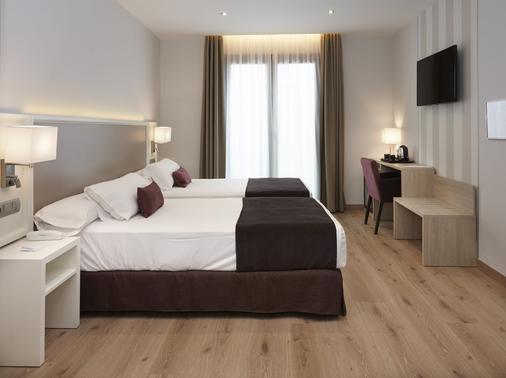 梅斯特拉萨酒店 - 隆达 - 睡房