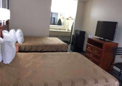 塔斯卡卢萨美洲最佳价值酒店 - 塔斯卡卢萨 - 睡房