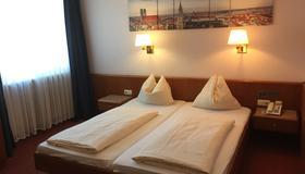 卡门酒店 - 慕尼黑 - 睡房