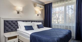 欧洲酒店 - 利沃夫 - 睡房