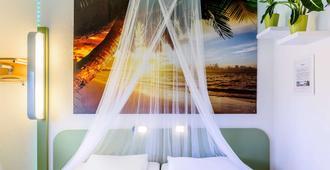 宜必思柏林库达姆大街酒店 - 柏林 - 睡房