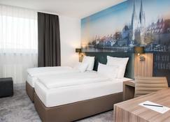 雷根斯堡公园 Achat 酒店 - 雷根斯堡 - 睡房
