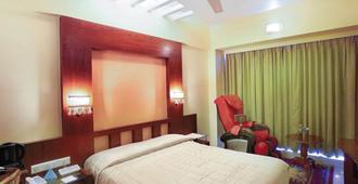 苏杭安酒店 - 孟买 - 睡房