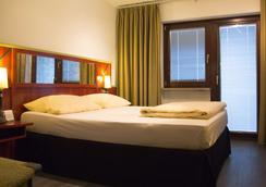 维尔兹堡帕斯特酒店 - 维尔茨堡 - 睡房